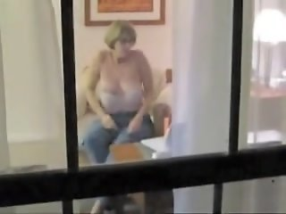 Naked mature woman voyeured..