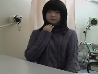 Young Japanese girl reaches..