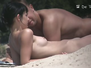 Beach couple making out nude..