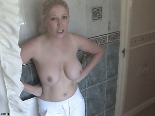 Lovely blonde shows tits in..