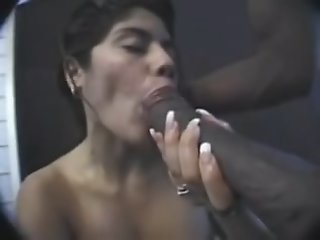 Latina sucks a big black..