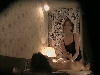 Asian masseuse giving a..