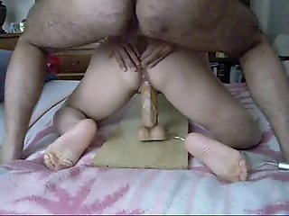 Mature wife using a big..