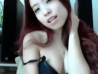 Comely Teen Redhead..
